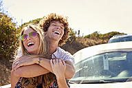Carefree couple hugging outdoors in summer - WESTF21984