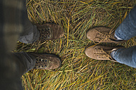 Legs of a couple standing in grass - KKAF00085