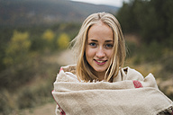 Portrait of smiling young woman outdoors - KKAF00097