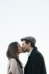 Couple kissing in front of sky - KKAF00121