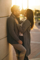 Couple in love face to face at sunset - KKAF00136