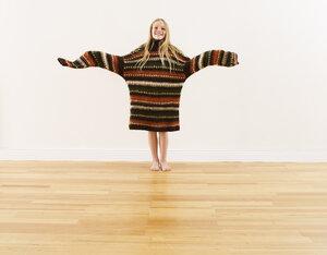 Girl wearing oversized knit pullover - FSF00642