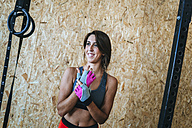 Smiling woman in gym - KIJF00936