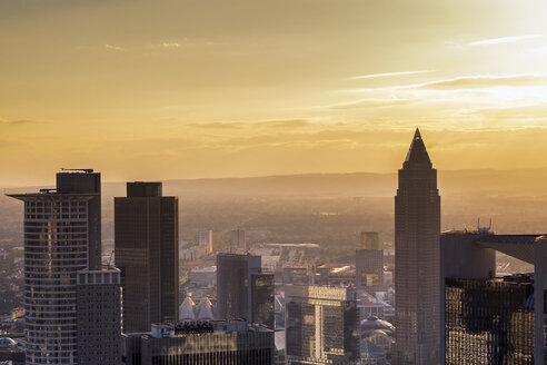 Germany, Frankfurt, skyscrapers at sunset seen from above - KRPF02054