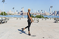 USA, New York City, Brooklyn, smiling young woman - GIOF01667