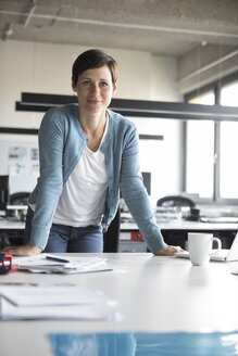 Portrait of confident businesswoman in office - RBF05266