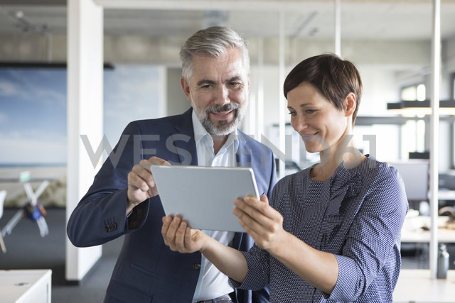 Businessman and businesswoman with tablet in office - RBF05281 - Rainer Berg/Westend61