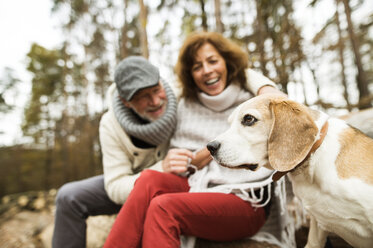 Happy senior couple with dog in nature - HAPF01154