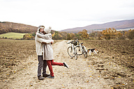 Senior couple doing a bicycle trip with dog - HAPF01172