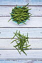 Bowl of green beans on wood - LVF05644