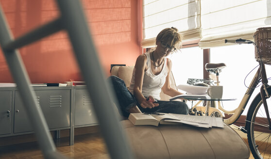 Woman at home working on script - MGOF02665