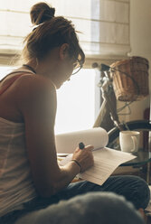 Woman at home working on script - MGOF02671