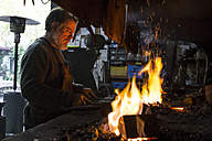 Blacksmith at work in his workshop - ABZF01574