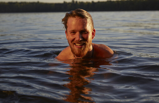 Happy young man in a lake - FMKF03299