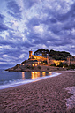Spain, Costa Brava, Tossa de Mar, main beach and old town wall at dusk - ABOF00126