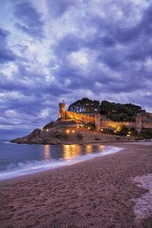 Spain, Costa Brava, Tossa de Mar, main beach and old town wall at dusk - ABOF00126