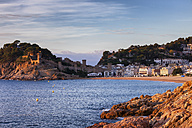 Spain, Costa Brava, Tossa de Mar, town and Mediterranean Sea coast at sunrise - ABOF00129