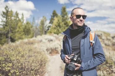 USA, Wyoming, man with camera at Grand Teton National Park - EPF00190