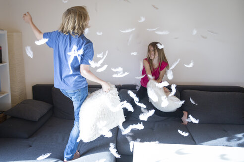 Pillow fight between brother and sister at home - SARF03085
