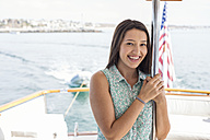 Smiling young woman on a boat trip - WESTF22209
