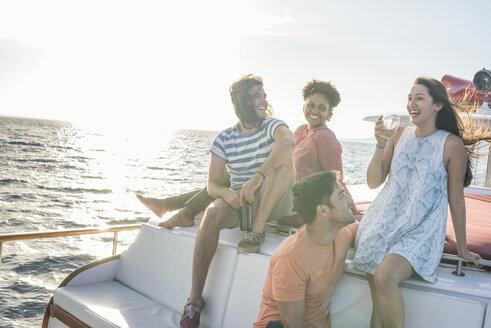 Happy friends on a boat trip having a drink - WESTF22263