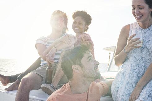 Happy friends on a boat trip having a drink - WESTF22266