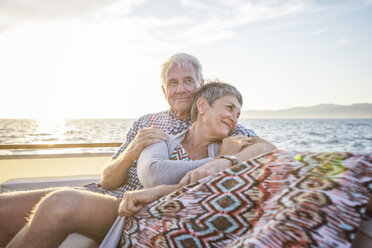 Affectionate couple on a boat trip at sunset - WESTF22293