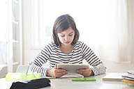 Girl doing homework with tablet - LVF05669