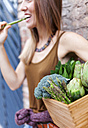 Smiling woman holding basket with fresh vegetables - VABF00906