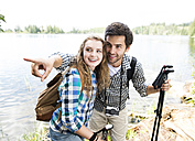 Young couple on a hiking tour at a lake - HAPF01181