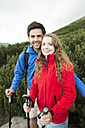 Portrait of smiling young couple on a hiking tour - HAPF01202