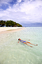 Maldives, Gulhi, woman floating in shallow water - DSGF01257
