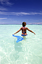 Maldives, woman standing in shallow water - DSGF01260
