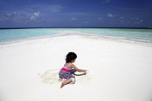 Maldives, girl on beach at shallow water - DSGF01269