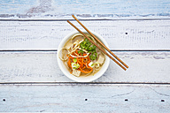 Bowl of miso soup with organic tofu, carrot noodles, parsnip, leek, glass noodles and parsley - LVF05702