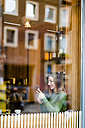 Young woman sitting in coffee shop - TAMF00893