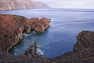 Spain, Tenerife, Evening view of Gigantes cliffs and ocean - DSGF01315