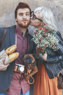 Young couple with dog kissing outdoors - RTBF00568