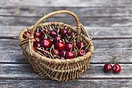Wickerbasket of sweet cherries - GWF04916
