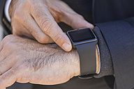 Close-up of businessman with smartwatch - TCF05208