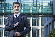 Confident businessman outdoors - TCF05220