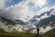 Italy, Umbria, hiker at Monte Cucco Regional Park in autumn - LOMF00459