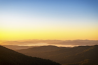 USA, North Carolina, view from Blue Ridge Parkway to Pisgah Forest at early morning mist - SMAF00629