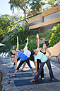 Yoga instructor teaching a group - ABAF02116