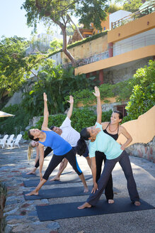 Yoga instructor teaching a group - ABAF02116