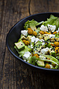 Bowl of leaf salad with roasted chick-peas, avocado, feta and black sesame - LVF05713