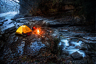 Austria, Salzburg State, Tennengau, senior man camping at Taugl brook - HHF05486