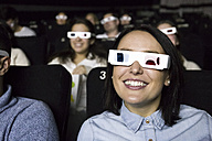 Woman with 3d glasses watching a movie in a cinema - ABZF01635