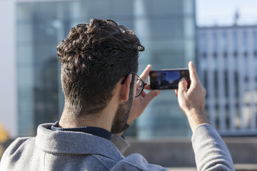 Back view of man taking picture with smartphone - TCF05241