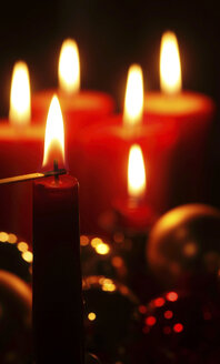 Match lighting red Christmas candle - JTF00790